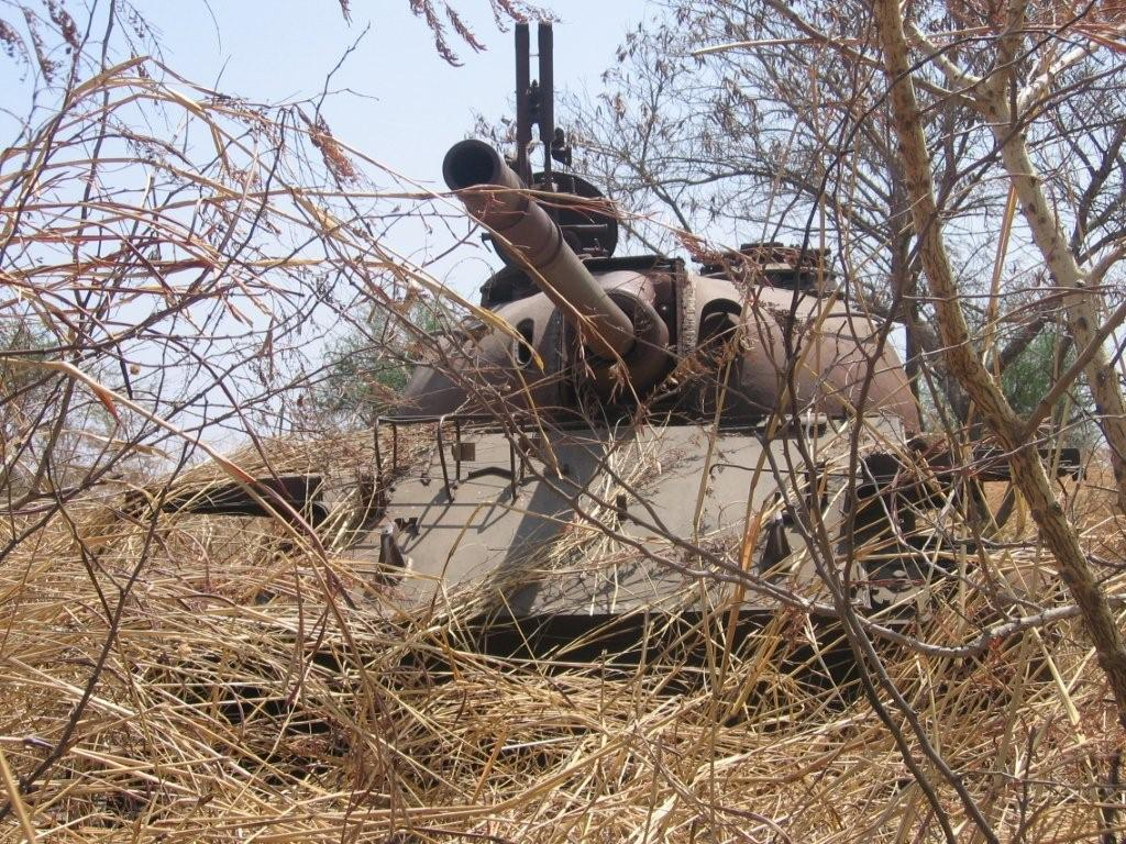 Destroyed Sudanese army tank, outside Malakal (Simon Roughneen, Feb 2006)