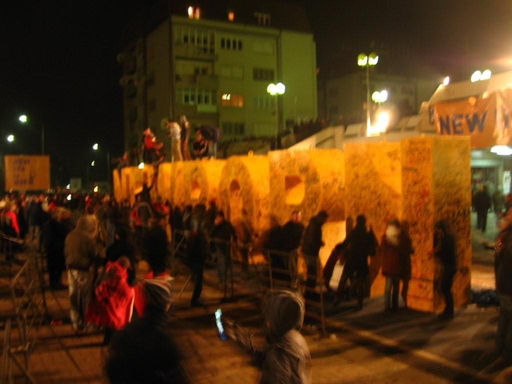 Partying at the Newborn Sq, downtown Pristina, Feb 2008 (Simon Roughneen)