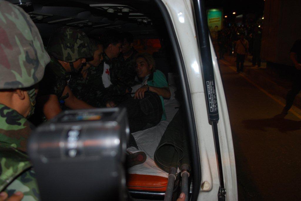 Injured man taken away by ambulance (Photo: Simon Roughneen)