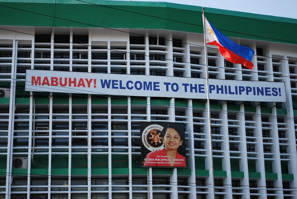 On the way out: Arroyo billboard near old city of Intramuros in Manila (Photo: Simon Roughneen)