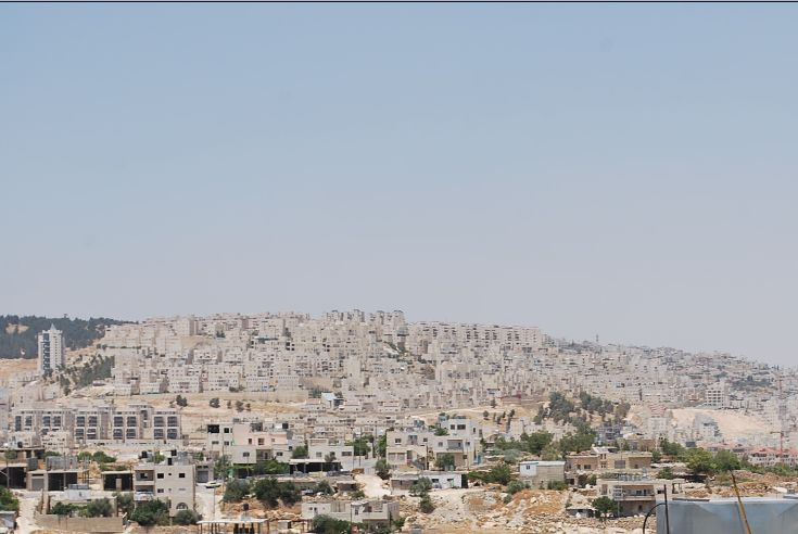 In the distance a Jewish settlement, as pictured from inside Bethlehem in the West Bank. (Photo: Simon Roughneen)