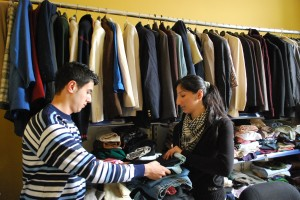 Sarmad and Sandra packing clothes for fellow refugees in Istanbul (Photo: Simon Roughneen)