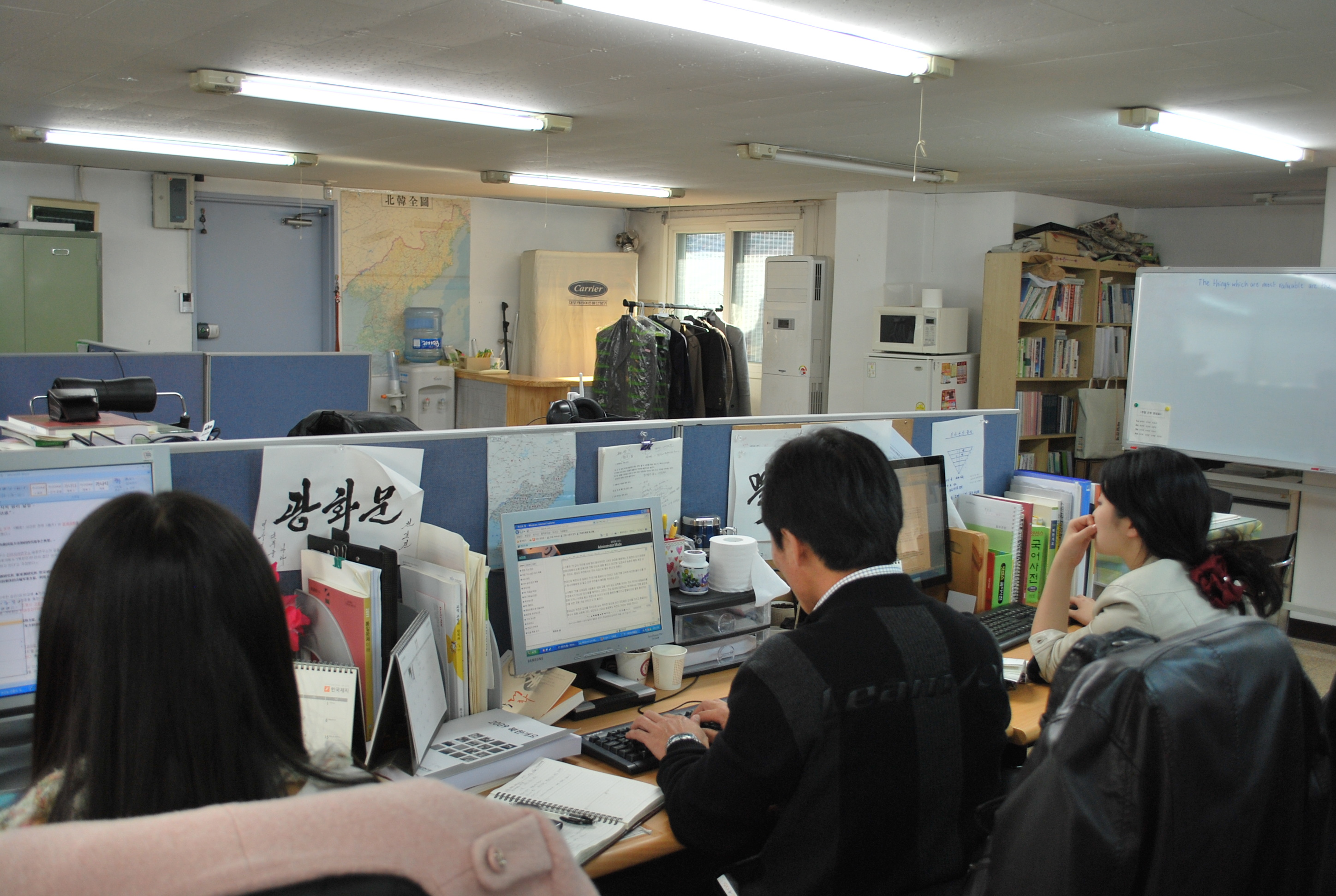 Byoung-Keun (middle) at work at the DailyNK office in Seoul. Photo by Simon Roughneen.