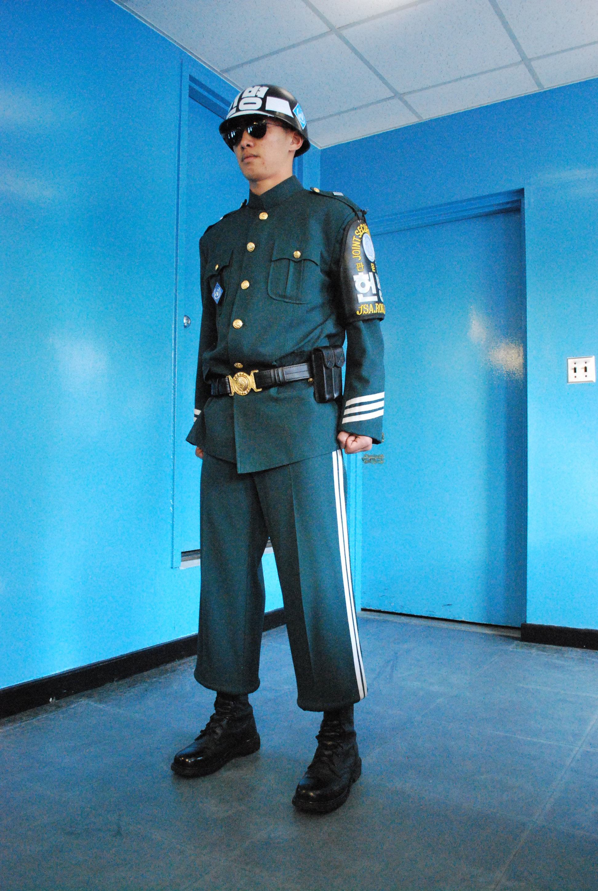 South Korean soldier stans guard in the conference room that straddles the border between North and South Korea. The door behind leads to a room full of North Korean soldiers (Photo: Simon Roughneen)