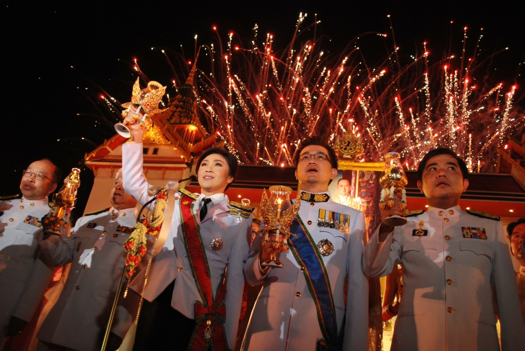 Thailand's PM Yingluck Shinawatra leads Bangkok candle-lighting celebration to mark Thai King's birthday  in 2011 (Photo: Simon Roughneen)