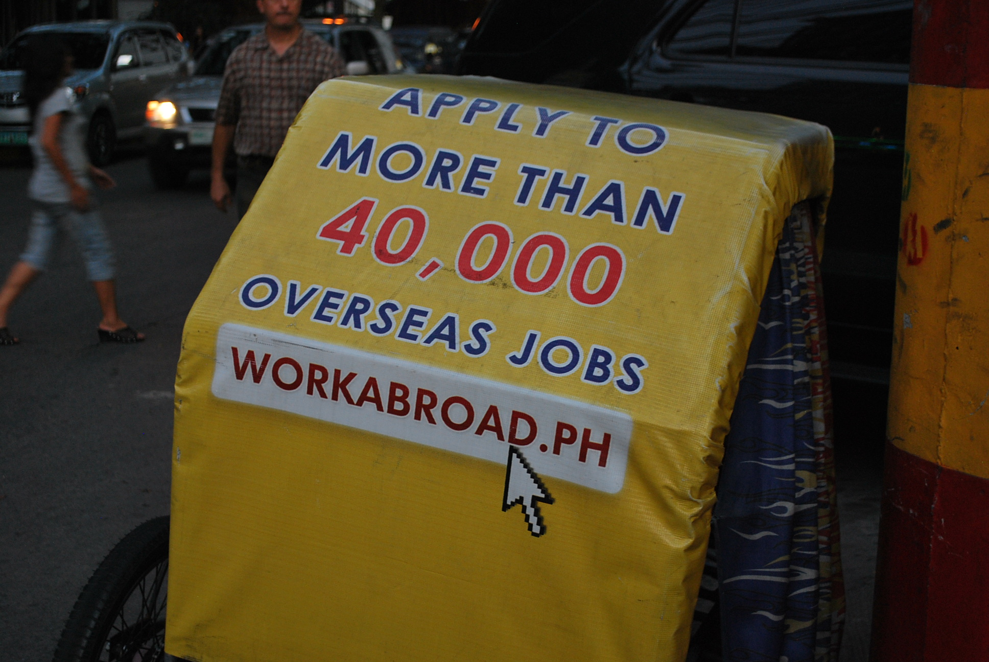 Advertisement on the back of tuk-tuk in Manila. Around 10 million Filipinos work abroad, sending billions of pesos in remittances back home to support families in a long-ailing economy (Photo: Simon Roughneen)