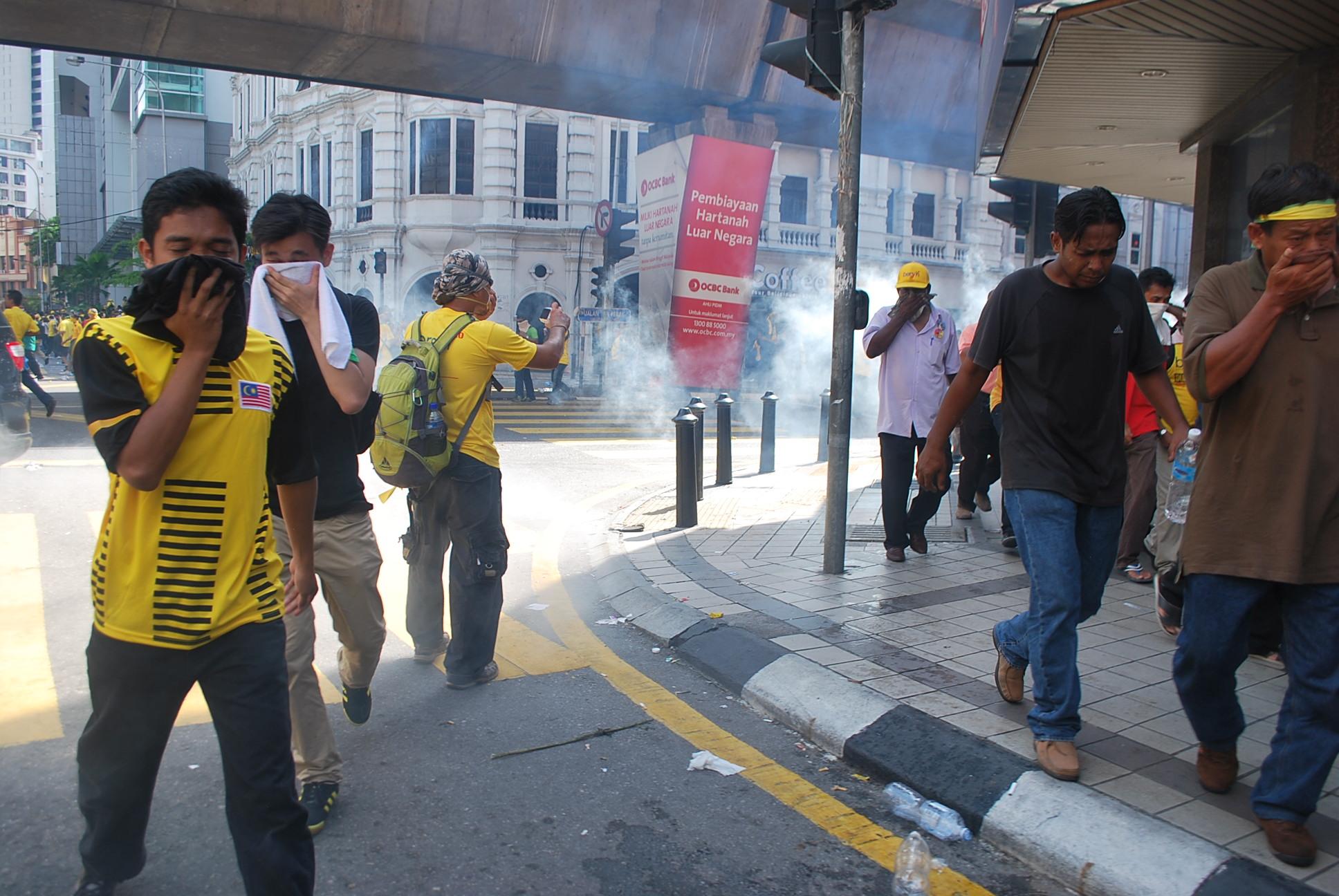 Protestors flee teargas in Kuala Lumpur on April 28 (Photo: Simon Roughneen)