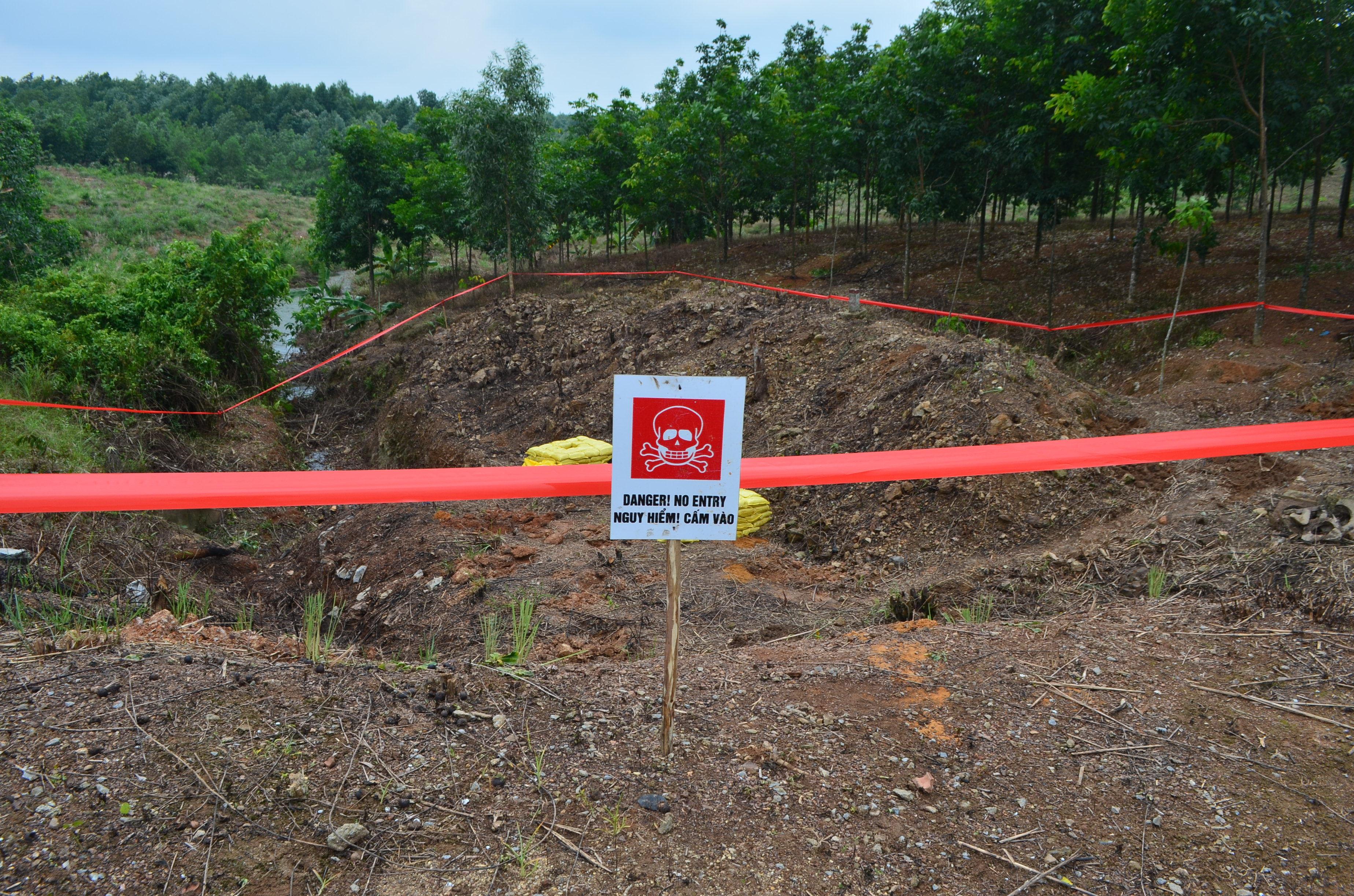 Site cordoned off by MAG for controlled explosion of UXO found several days ago (Photo: Simon Roughneen)