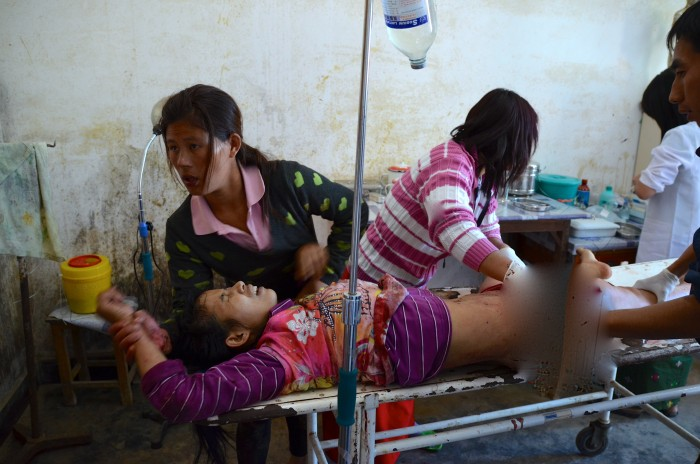 Medics at Laiza hospital tend to Lamong Kailing, injured by Burma army shelling outside Laiza on December 27 (Photo: Simon Roughneen)