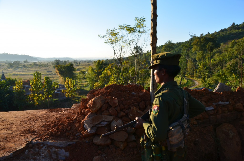 Kachin rebel on look-out at captured Burma Army position outside Laiza, the rebel HQ (Photo: Simon Roughneen, late December 2012)