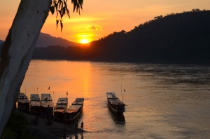 Sunset over the Mekong River running past Luang Prabang in Laos (Photo: Simon Roughneen)