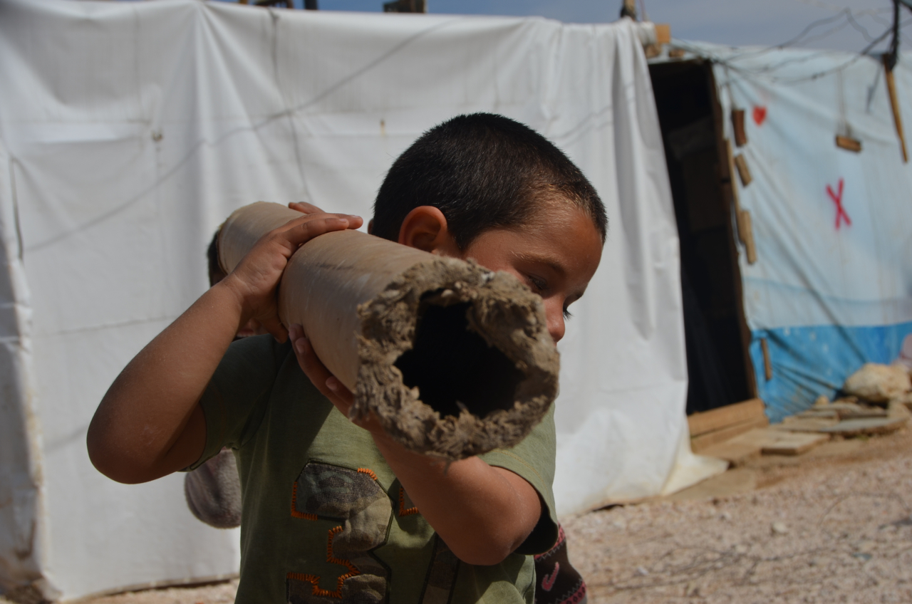 Syrian kids play war in refugee camp in Lebanon (Photo: Simon Roughneen)