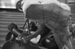 Solo becak driver takes an afternoon nap (Photo: Simon Roughneen)