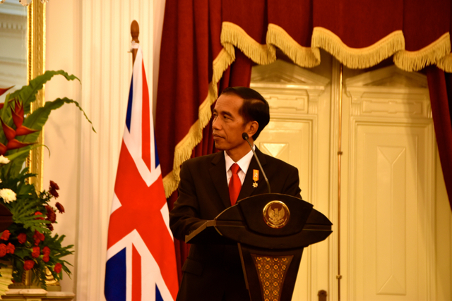 Indonesia President Joko Widodo listens as UK Prime Minister David Cameron speaks to media in Jakarta on July 27 (Photo: Simon Roughneen)