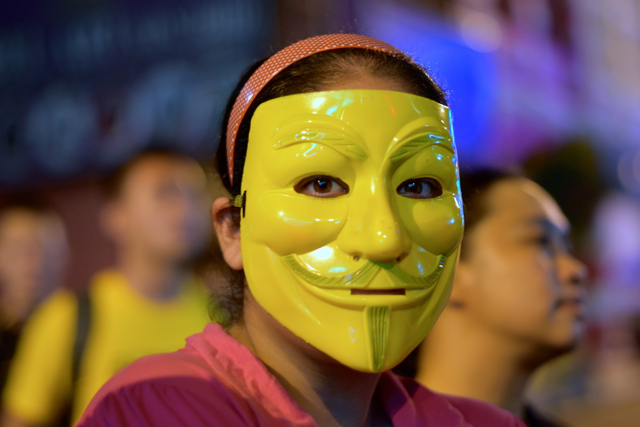 Protestors wearing 'occupy' style masks in Kuala Lumpur on Aug. 29 (Photo: Simon Roughneen)