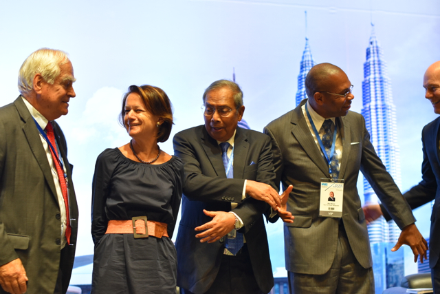 Conference speakers baffled by Sarawak chief minister Haji Adenan bin Satem's attempt to replicate the handshake pose used by ASEAN heads of government at official meetings (Photo: Simon Roughneen)