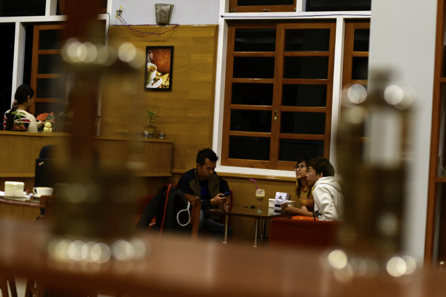Evening time inside Café de Angel, a popular Taungyyi coffeeshop (Photo: Simon Roughneen)