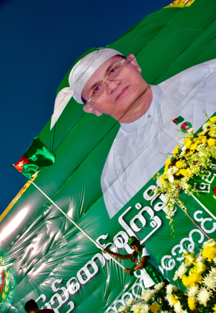 82 - Flying the flag: USDP supporter onstage at the party's final rally in Yangon on Nov. 6 (Photo: Simon Roughneen)