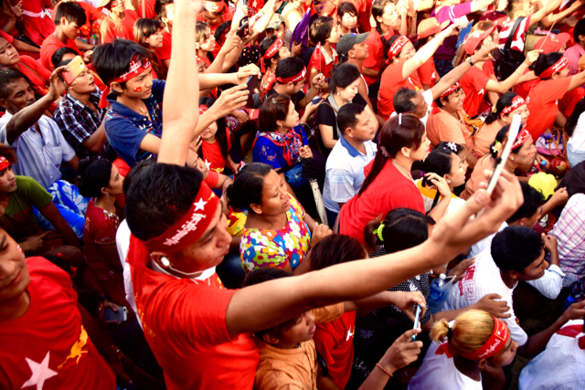 upporters of the opposition NLD point their phones at party leader Aung San Suu Kyi as she takes to the stage at the party's final Yangon rally on Nov. 1 (Photo: Simon Roughneen)