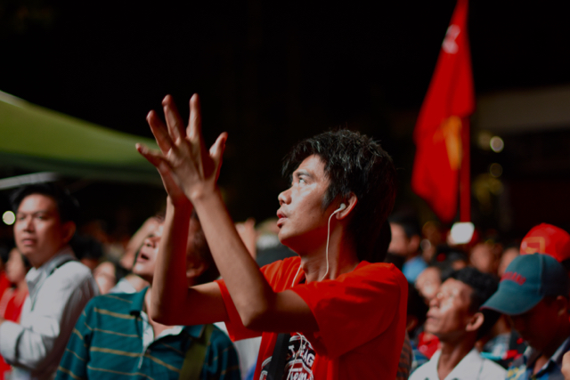 NLD supporters watch as Myanmar television broadcasts vote counting on a big screen outside NLD headquarters in Yangon. (Photo by Simon Roughneen)