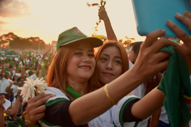 Selfie time: supporters of the ruling USDP pose after the party's final election rally on Nov. 6 (Photo: Simon Roughneen)