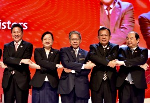 Laos Minister of Industry and Commerce Khemmani Pholsena (second from left) poses with counterpart ministers from other ASEAN member states in Kuala Lumpur on Nov. 20. (Photo: Simon Roughneen)