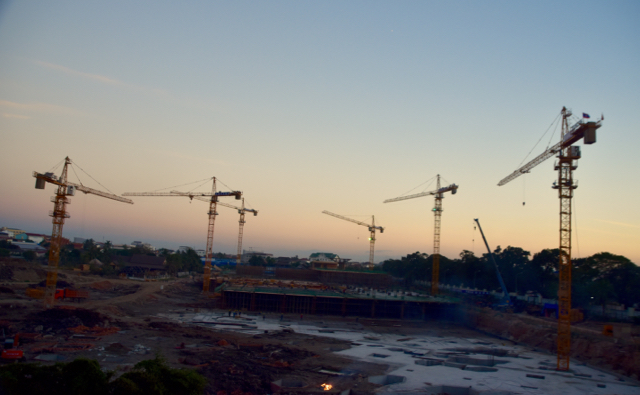 Cranes in a construction site for one around 20 malls going up in Vientiane. Jan. 2016 (Photo: Simon Roughneen)