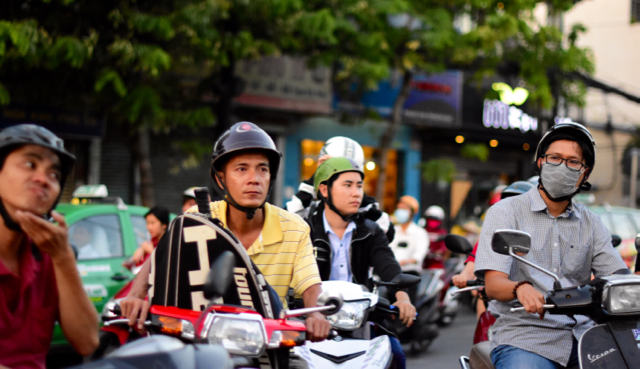 Motorcyclists wait at traffic lights in Ho Chi Minh City (Photo: Simon Roughneen)