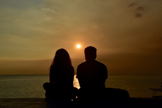 Couple catching the sunset outside SM Mall of Asia on Manila's waterfront (Photo: Simon Roughneen)