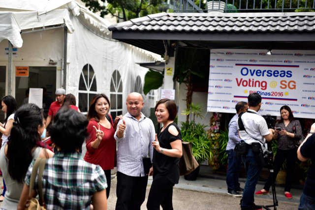 Voters pose for photographs after casting their ballots at the Philippine embassy in Singapore (Photo: Simon Roughneen)