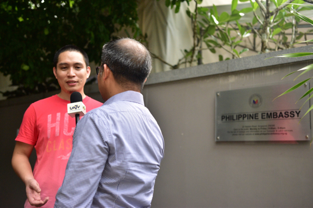 Voter speaks to Filipino TV crew after voting at the embassy in Singapore (Photo: Simon Roughneen)