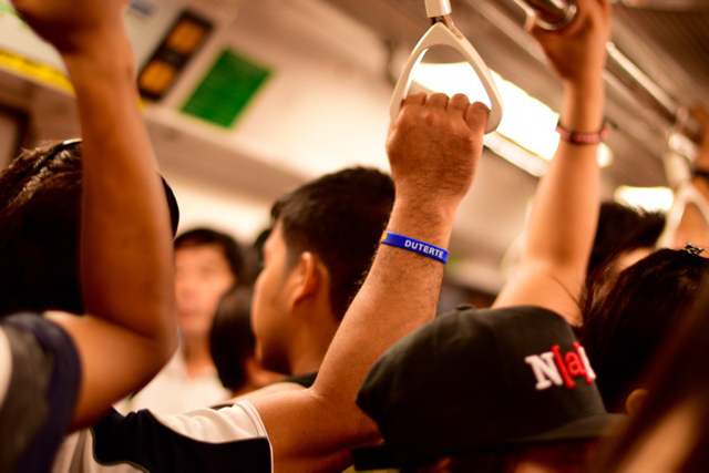 Supporter of Rodrigo Duterte, the controversial front-runner to win the May 9 presidential election, seen on the Singapore metro (Photo: Simon Roughneen)