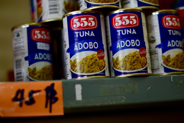 Tinned adobo, a favourite Filipino meal, stacked up inside The Filipino Shop in Bangkok (Photo: Simon Roughneen)