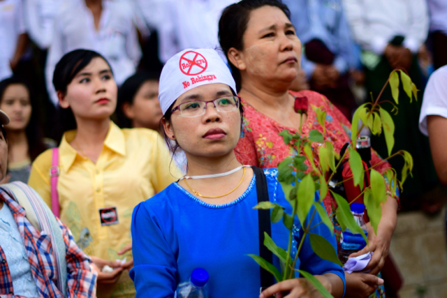 Female protestor looks on as demonstrators chant anti-Rohingya slogans outside the US embassy in Yangon on April 28 (Photo: Simon Roughneen)