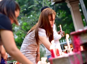 Filipina churchgoers light candles in the grounds of St John's Cathedral in Kuala Lumpur (Photo: Simon Roughneen)