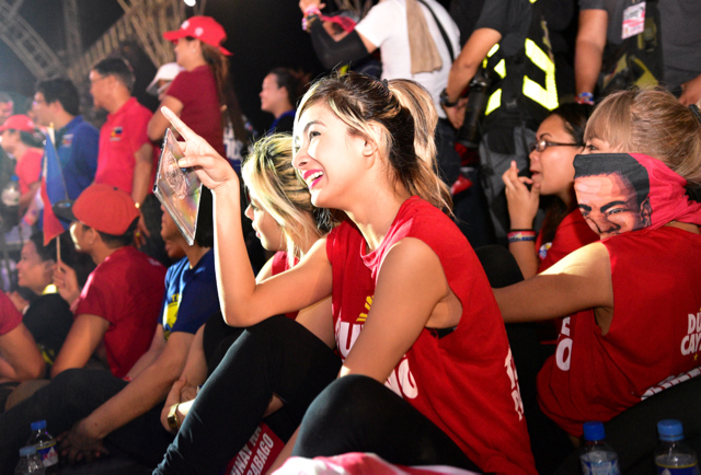 Member of the Mocha Girls, a pop/dance act that performed onstage at Duterte's final election rally in Manila on May 7, looks on as Duterte speaks (Photo: Simon Roughneen
