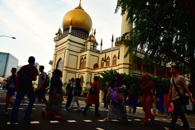 Pedestrians crossing near the Sultan Mosque in Singapore as fasting time comes to an end. (Photo: Simon Roughneen)