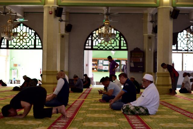 Men at evening prayer inside the Sultan Mosque in Singapore. (Photo: Simon Roughneen)