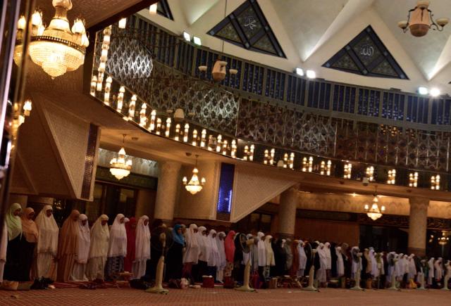 Women at prayer inside the National Mosque in Kuala Lumpur.  (Photo: Simon Roughneen)