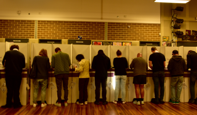 Voters marking their ballot papers inside polling station in central Sydney
