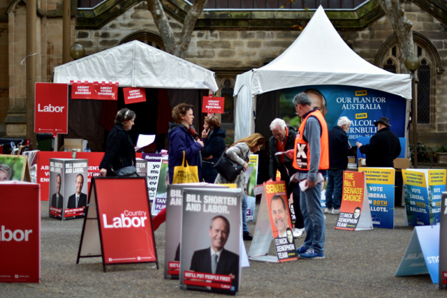 Party volunteers canvassing for votes at Sydney Town Hall, shortly before the close of voting on July 2