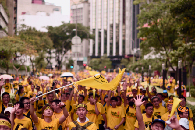 Protestors on the march across Kuala Lumpur after police blocked access to the city's main plaza (Photo: Simon Roughneen)