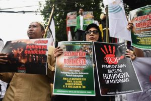 "Indonesian protestors denounce Myanmar's treatment of the Muslim Rohingya minority during a Nov. 25 demonstration outside the Myanmar embassy in Jakarta. (Photo"" Simon Roughneen)"