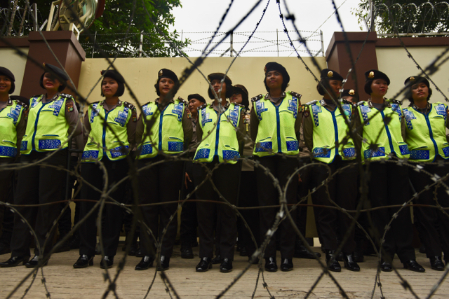 Indonesian police stand guard at the Myanmar embassy in Jakarta on Nov. 25 (Photo: Simon Roughneen)