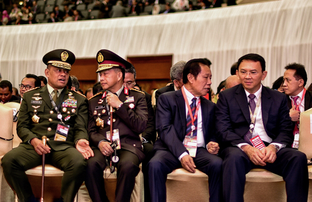 Jakarta Governor Basuki Tjahaja Purnama (far right) seated near senior Indonesian police and military at the World Islamic Economic Forum in Jakarta on August 2 2016 (Photo: Simon Roughneen)