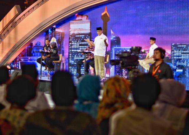 Candidate Anies Basdewan speaking onstage during the final gubernatorial election debate on Feb. 10 in Jakarta (Photo: Simon Roughneen)