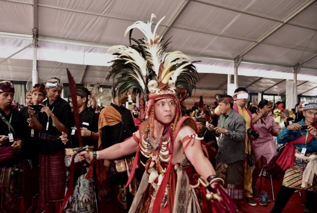 Indigenous activists putting on a traditional dance performance at the recent AMAN conference in Tanjung Gusto, north Sumatra. (Photo: Simon Roughneen)