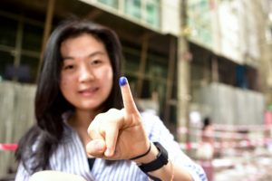 A voter pictured after casting her ballot in Yangon's Chinatown on ​Saturday morning (Photo: Simon Roughneen)