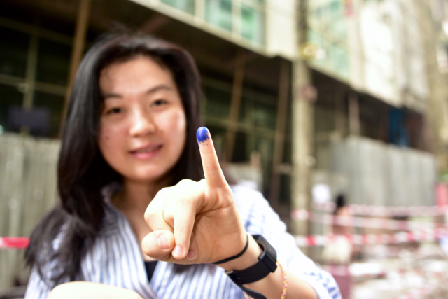 A voter pictured after casting her ballot in Yangon's Chinatown on Saturday morning (Photo: Simon Roughneen)