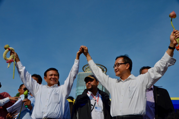 Opposition leaders Kem Sokha and the now-exiled Sam Rainsy at a party rally in Phnom Penh in Sept. 2013 (Photo: Simon Roughneen)